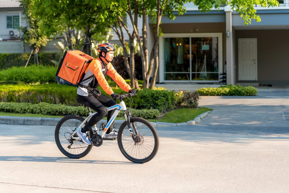 A delivery agent on a bike